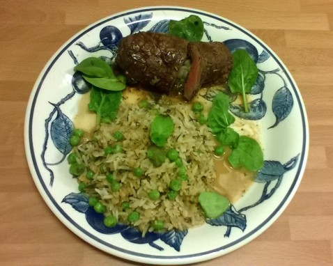 Stuffed, rolled heart steak with rice, coconut milk and spinach.